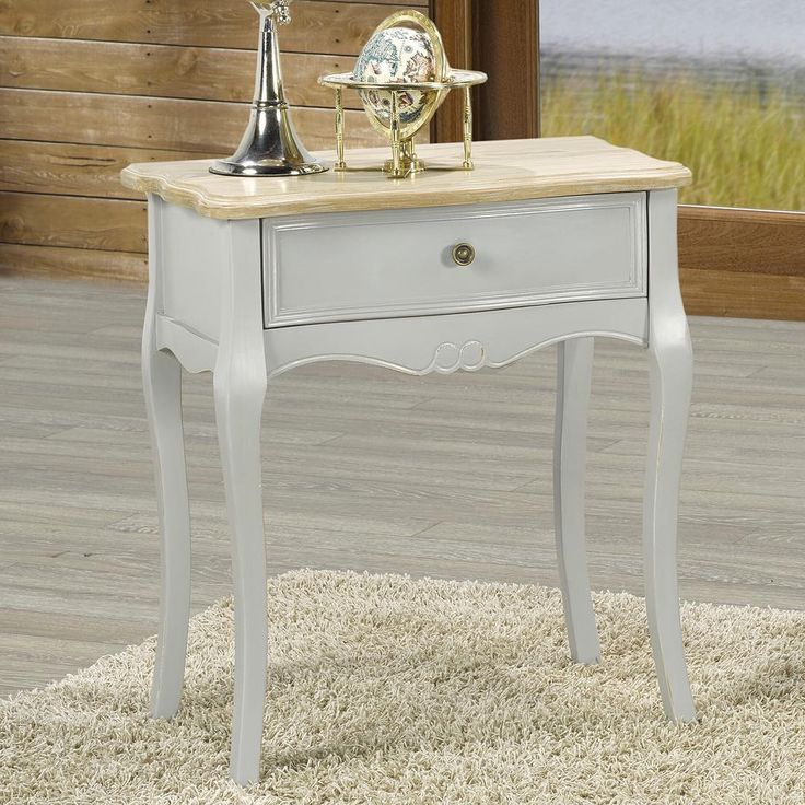 The Marcela collection is lovely in a French-Country kind of way...   http://worldwidehomefurnishingsinc.com/marcela-accent-table-in-grey.html