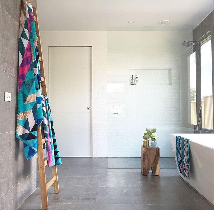 Love this bathroom. Grey Matte tiles and gloss white tiles