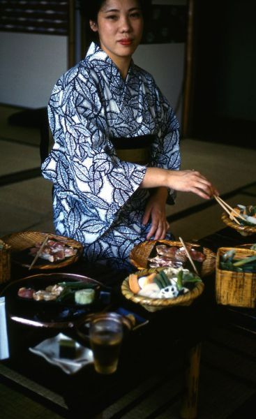 This kimono lady prepares Nabe, pot cook with broth. It was natural that customer only has to eat what is served. Very Japanese. 着物の女性が鍋の準備をしています。お客様のために調理するこの姿は非常に日本らしいです。