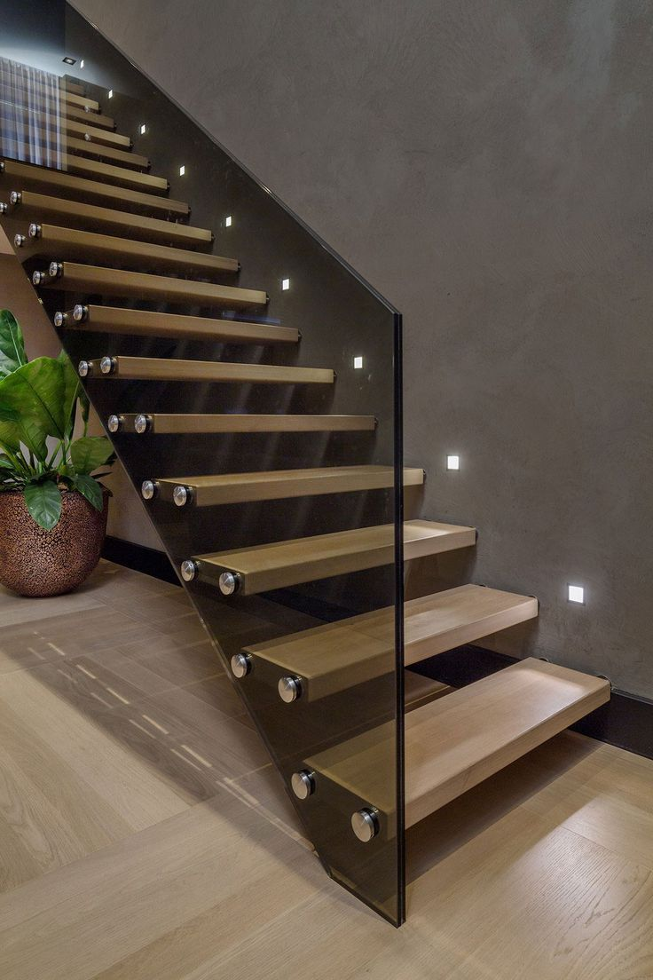 Interior Contemporary Floating Wooden Sttaircase Idea With Stainless Steel Nails And Dark Glass