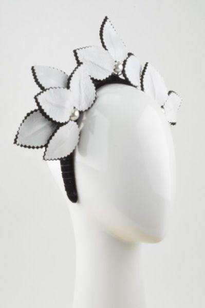 Rebecca Share teaches you simply how to tool elegant leather flowers then add to a Crown with a halo as a standout piece. #millinery #hatacademy