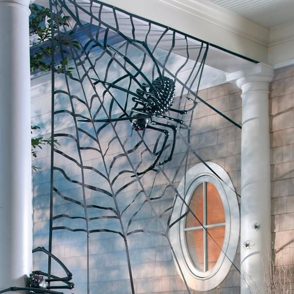 Corner the market on supersized scares in your neighborhood with our enormous Corner Spiderweb. What a treat for the ghosts and goblins who dare to creep around your lair, come Halloween. Our more than 5 ft.-high spiderweb has been specially designed to be displayed in square spaces, indoors or out. Short on corners at your house? Here's a trick: get crafty. Drape the web over a fence, furniture, or hang it from tree limbs or a chandelier. An arachnofabulously good value, too...