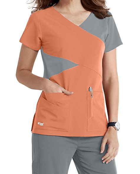 GREY'S IN COLORS Infuse fashion into the workplace with the stylish Grey's Anatomy Signature four-pocket mock wrap scrub top, now with Apricot/Moonstruck and White/Moonstruck color combinations. This cute top creates a unique look by combining detailed style lines and contrast color blocking. Two deep lower pockets, two pen slots and an extra PDA pocket are included to give you plenty of storage options. The super stretch fabric moves with you and is a pleasure to wear throug...