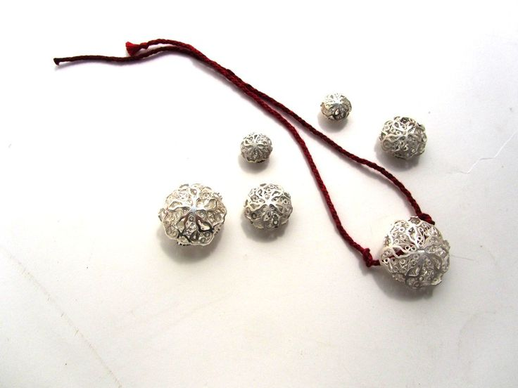 Sterling silver and filigree beads.