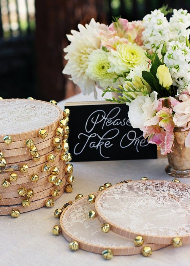 Handmade lace-tambourine favors welcome wedding guests on the sweetest note. #DIY