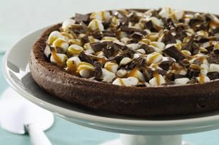Chocolate-Caramel Marshmallow Torte recipe - Chocolate cake is topped with chopped chocolate and mini marshmallows, then drizzled with melted caramels for a spectacular finish.