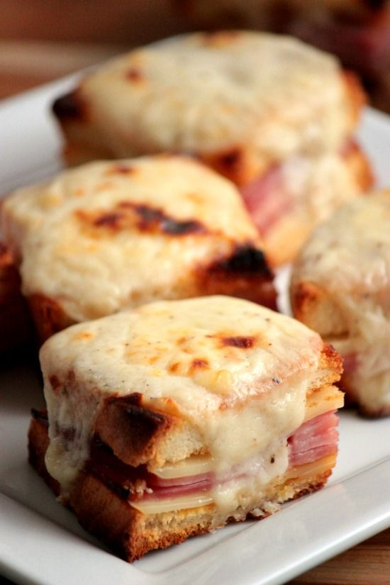 Mini Croque Monsieurs might sounds fancy but they're really just perfectly baked ham and cheese sandwiches with a simple cheesy Bechamel Sauce on top!