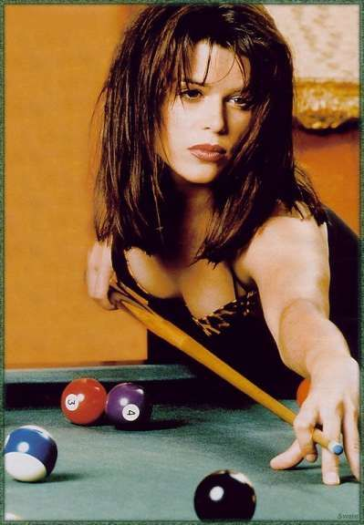 Neve Campbell playing pool.