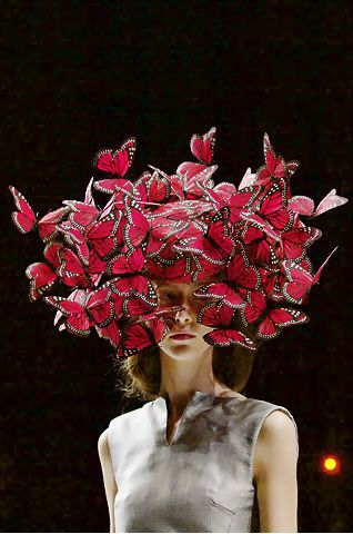 Phillip Treacy for McQueen. I like that the butterflies are such a big part of this design I would like mine to be heavily embellished.