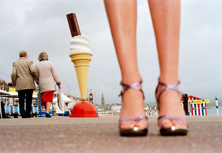 Martin Parr - I never fully understand why he photographs what he does, but there's a certain pleasantest and uniqueness to them. I guess ugly but beautiful?