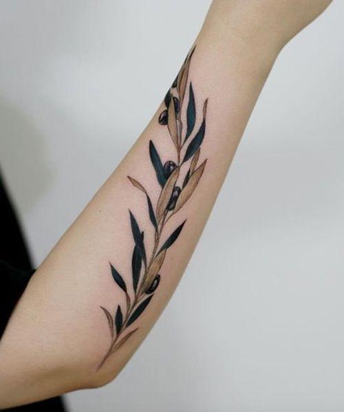 Cute Decent Leaf Branch Tattoo Design on Arm for Girls