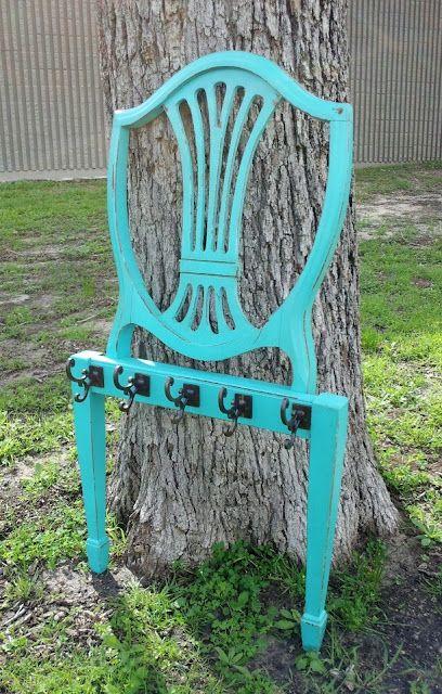 Scrap chair back upcycled into a rack for hanging coats, accessories, etc.