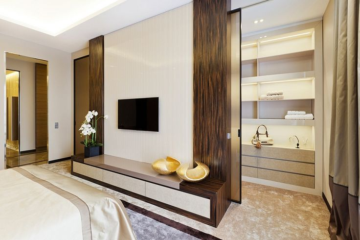 Lower-wooden-cabinet-with-mounting-tv-and-walk-in-closet-with-sliding-door-design-decorated-by-orchids-and-dazzling-ceiling-lamps.jpg
