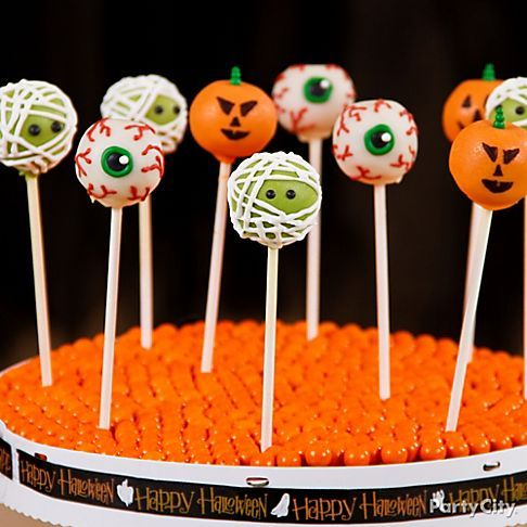 The best Halloween party food ideas are served on a stick! These eyeball and mummy cake pops are our faves :)