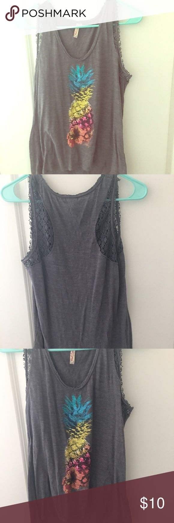 Grey tank top Grey tank top with a picture of a colorful pineapple in the middle 🍍never worn, great condition. Lace material around the shoulders Red Camel Tops Tank Tops