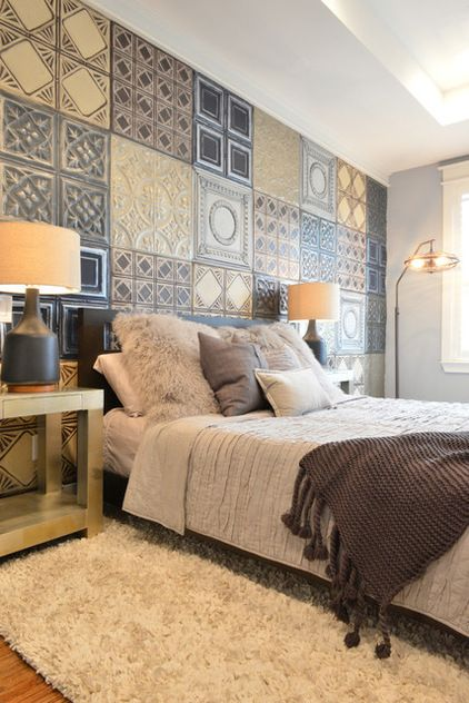 Love the painted tin ceiling tiles added as a very interesting headboard for the bed ~ Industrial Bedroom by Contour Interior Design, LLC
