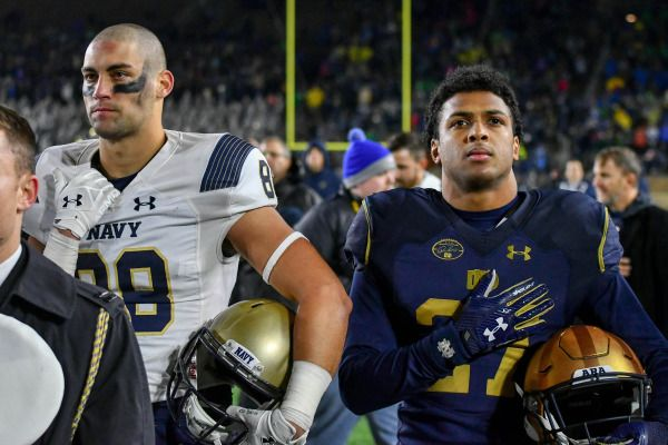 Nov 18, 2017; South Bend, IN, USA; Navy Midshipmen wide receiver Tyler Carmona (88) and Notre Dame Fighting Irish cornerback Julian Love (27) stand for the United States Naval Academy Alma Mater after the game at Notre Dame Stadium. Mandatory Credit: Matt Cashore-USA TODAY Sports