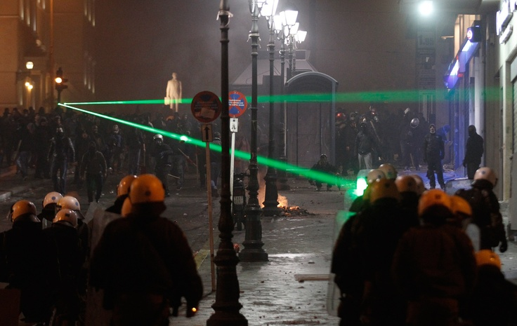 Standoff in Greece (with green laser pointers)