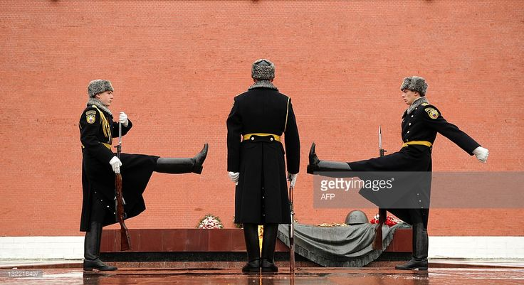 Soldiers of the Presidential Regiment take part in the Change of Guard ceremony at the Tomb of the Unknown Soldier just outside the Kremlin wall in Moscow , on November 11, 2011.