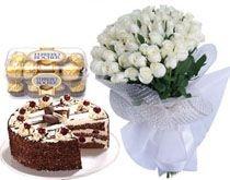 A Hamper Of 24 White roses bunch 16 Ferrero rocher chocolates 1/2 Kg cake.