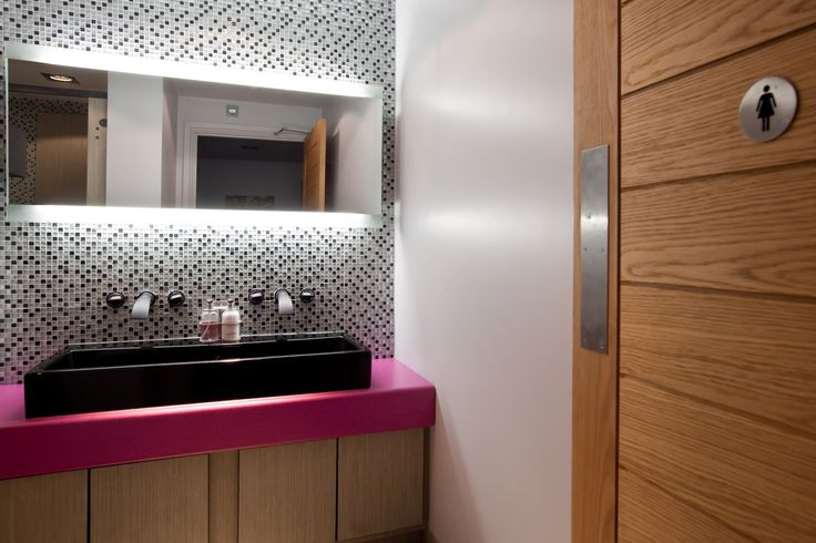 Ladies Restroom. Posh pink toilets in a stunning private entertainment venue. Copyright The Designer Knowledge. Photo by Ani Evans Photography.