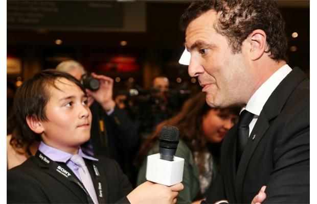 Canadian comedian, television personality, and actor, Rick Mercer, right, gets interviewed by Connor Mullen, age 11, of Kidz Hub Media Network on the red carpet at the CIFF opening gala in Calgary on Thursday.
