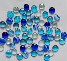 Gemengde formaten blauwe glazen knikkers