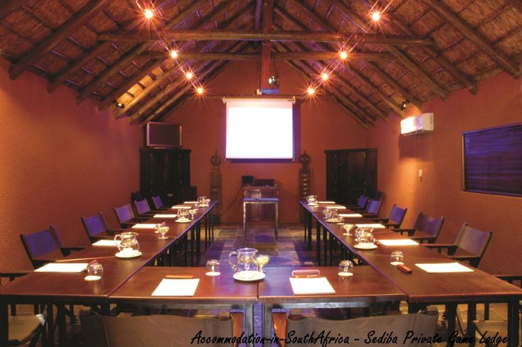 Conference at a game lodge.