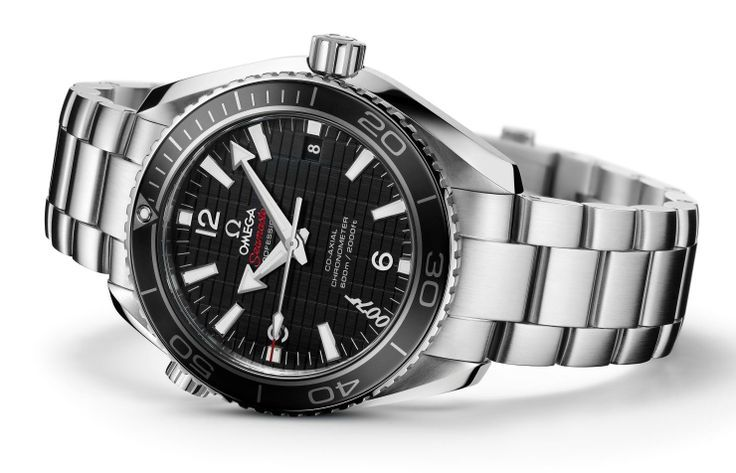 """Omega Seamaster James Bond Skyfall Watch 232.30.42.21.01.004.  The watch has a 42 mm brushed and polished stainless steel case and a matching patented screw-and-pin bracelet whose divers' clasp is engraved with """"007"""". The rotating diving bezel is distinguished by its matt black ceramic ring with a chromium nitride diving scale."""