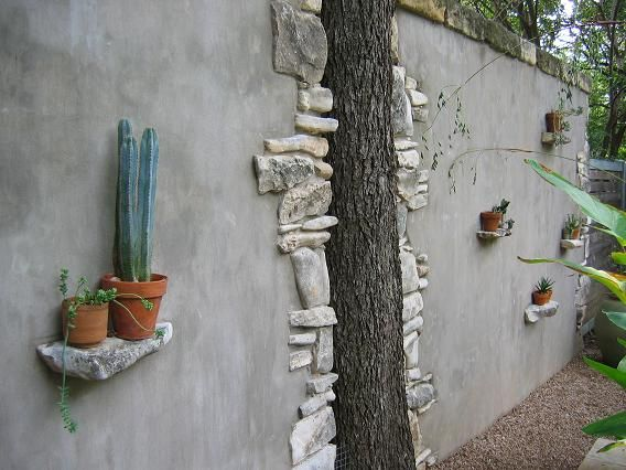 Cleverly built wall built around the tree, and I'm loving the built-in shelves.  Tour of Poth-Gill garden | Digging