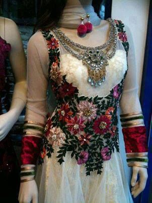Pakistani dress, i don't know the designer...but lovely dress... I would like the flowers in ice blue and red instead and cuffs in navy blue