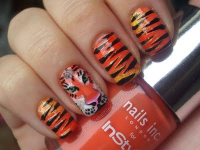 I had tiger nails in college but the tiger face would've been the icing on the cake!
