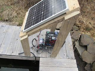 A Simple and Inexpensive High Lift Solar Pumping Setup - Stan was faced with a difficult garden watering problem in which he had to get water from a spring to a greenhouse that was located several hundred feet away and 50 ft uphill from the spring. The flow requirement was relatively small at about 3 gpm for for an hour and half a day about 3 times a week. Here's the solution...