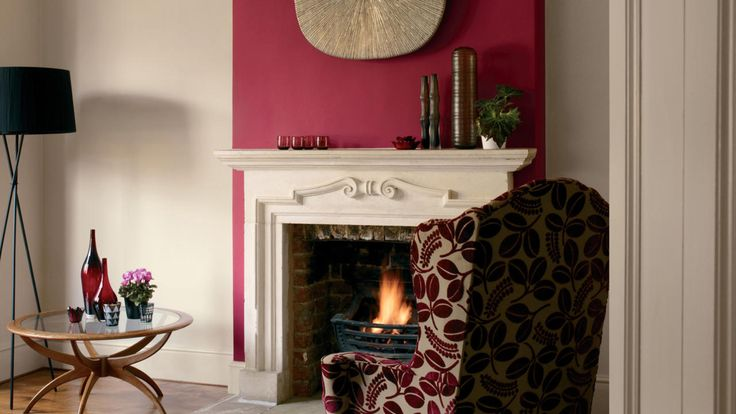 Accessorise a gentle pink living room with rich, jewel shades.