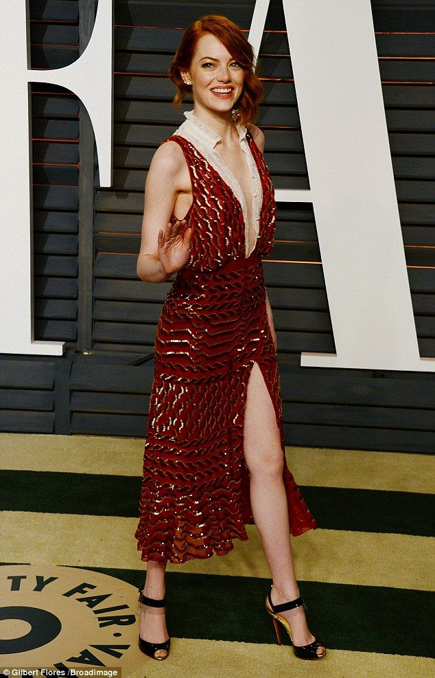 Wow-factor: Emma Stone was keen not to disappoint when she underwent a costume change for her attendance at the Vanity Fair Oscars afterparty - and chose another revealing dress