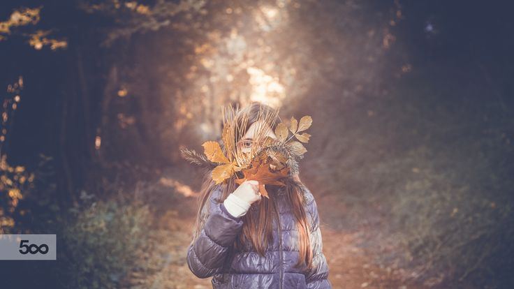 Young girl with a bunch of leaves