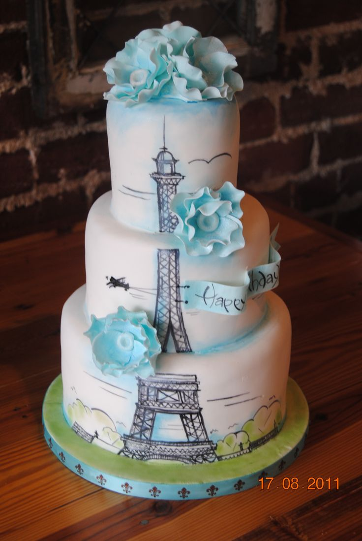Paris Birthday cake - Another version of our large eiffel tower cake this one with some color added as this cake is for a 17 year old girl who summers in Paris!  If you look closely, there is a plane pulling the Birthday banner.  Really a fun cake.   Yellow cake with vanilla bean IMBC. #siftedbakery #siftedbakery.com