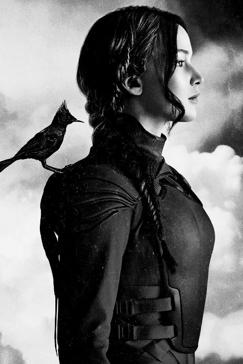 Promo picture of Jennifer Lawrence as Katniss Everdeen in Mockingjay Part 2 as in 1963