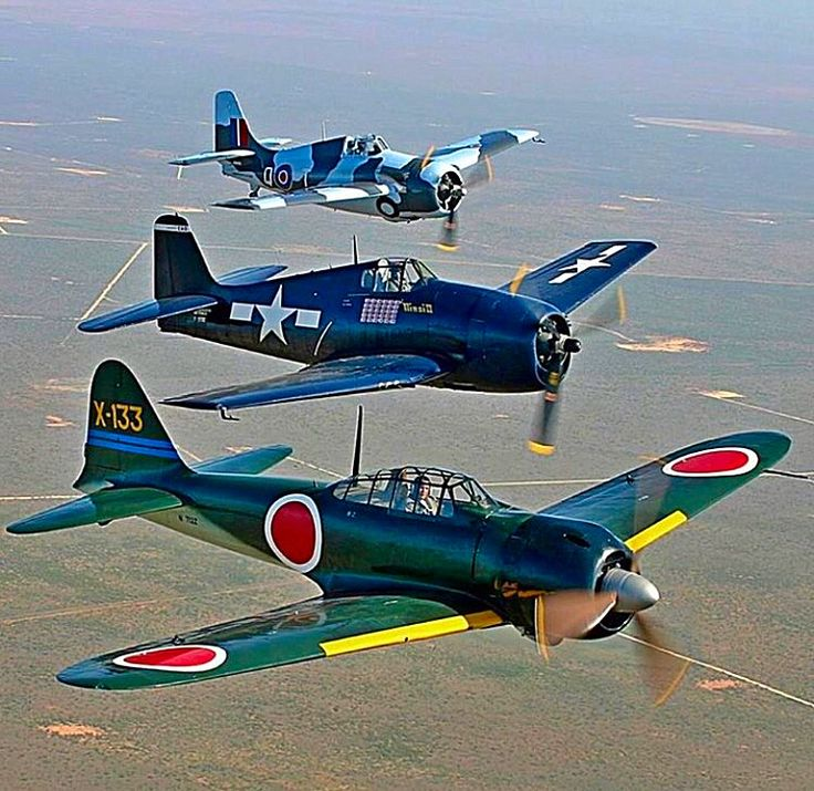 A Mitsubishi A6M Zero In Formation With A Pair Of Former