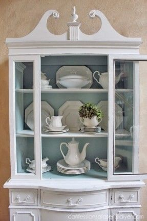 from http://foter.com/explore/white-corner-china-cabinet; I love the arrangement of dishes and tiny bit of greens; Chalk Painted China Cabinet