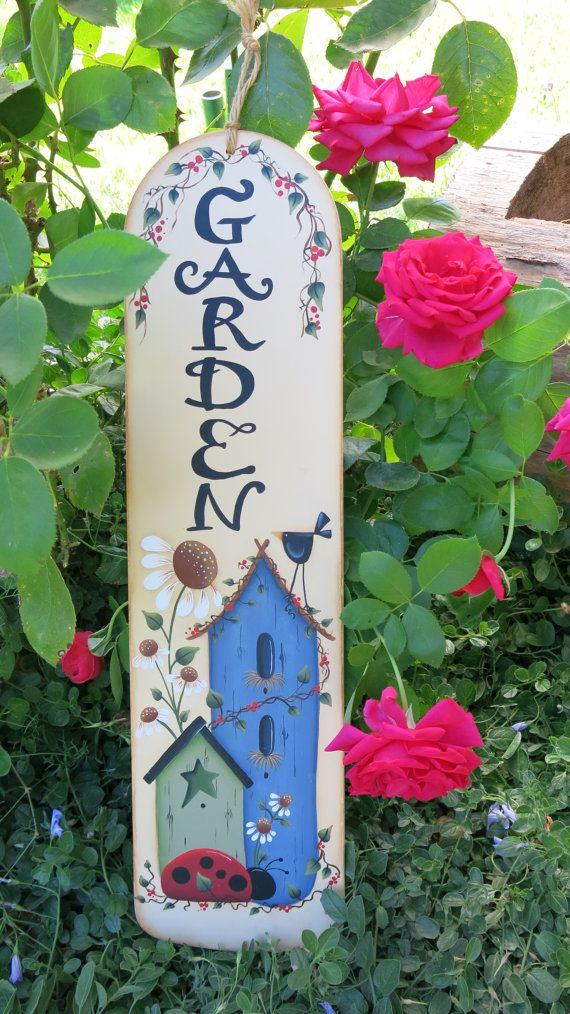 This recycled fan blade is painted cream with a Renee Mullins design. Birdhouses, ladybug, daisies, berries, bird and Garden all on this 20 1/2 x 5 7/8 blade. It has a jute hanger. This garden sign would look nice on a shaded patio or in a garden room. Its been sprayed with an interior matte varnish.