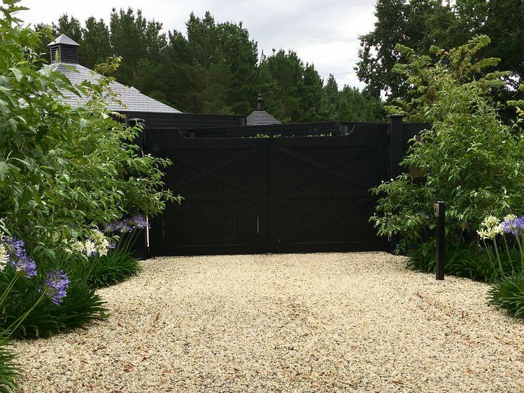 Ideal Mat black entrance gate with crab apples under planted with Aggies