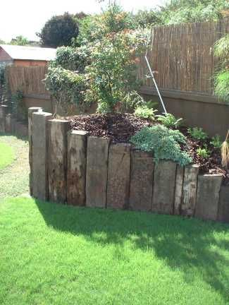 Upright railway sleeper garden bed