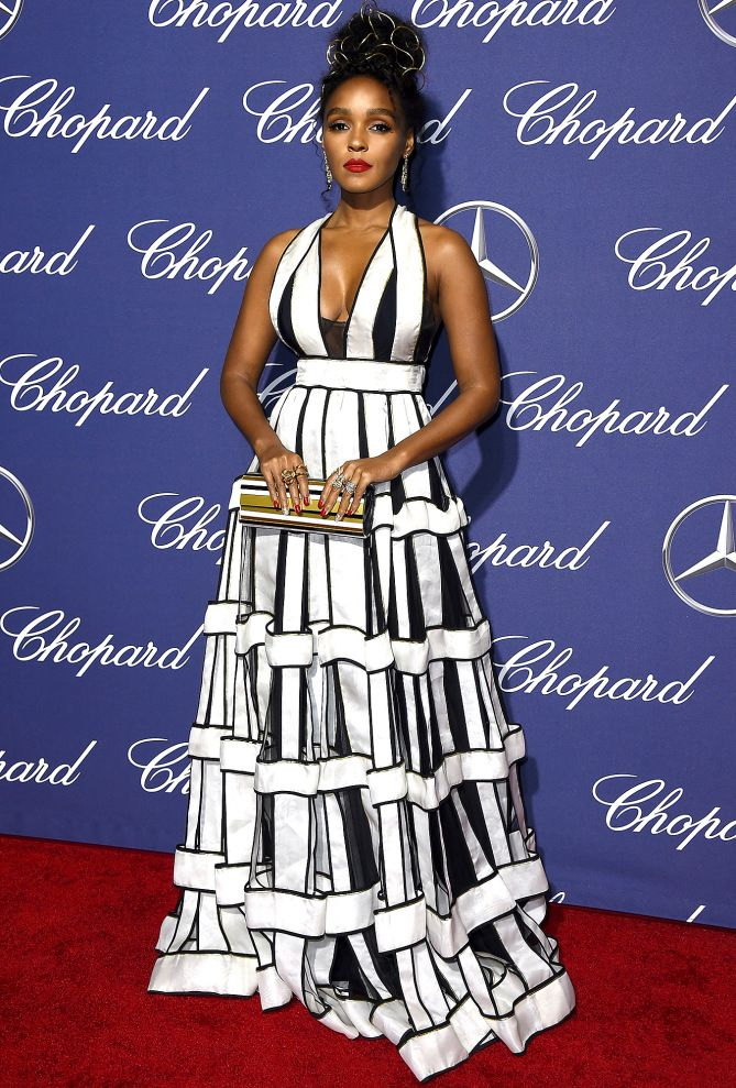 Janelle Monáe wears a geometric black and white patterned Jenny Packham gown with dangling drop earings and a box clutch to the Palm Springs International Film Festival Awards Gala.