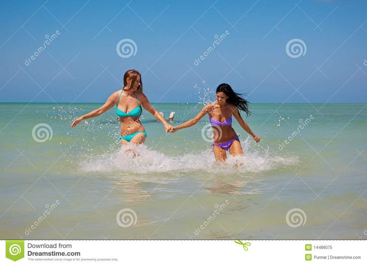 Girls Running Out Of Water Royalty Free Stock Photo - Image: 14486075