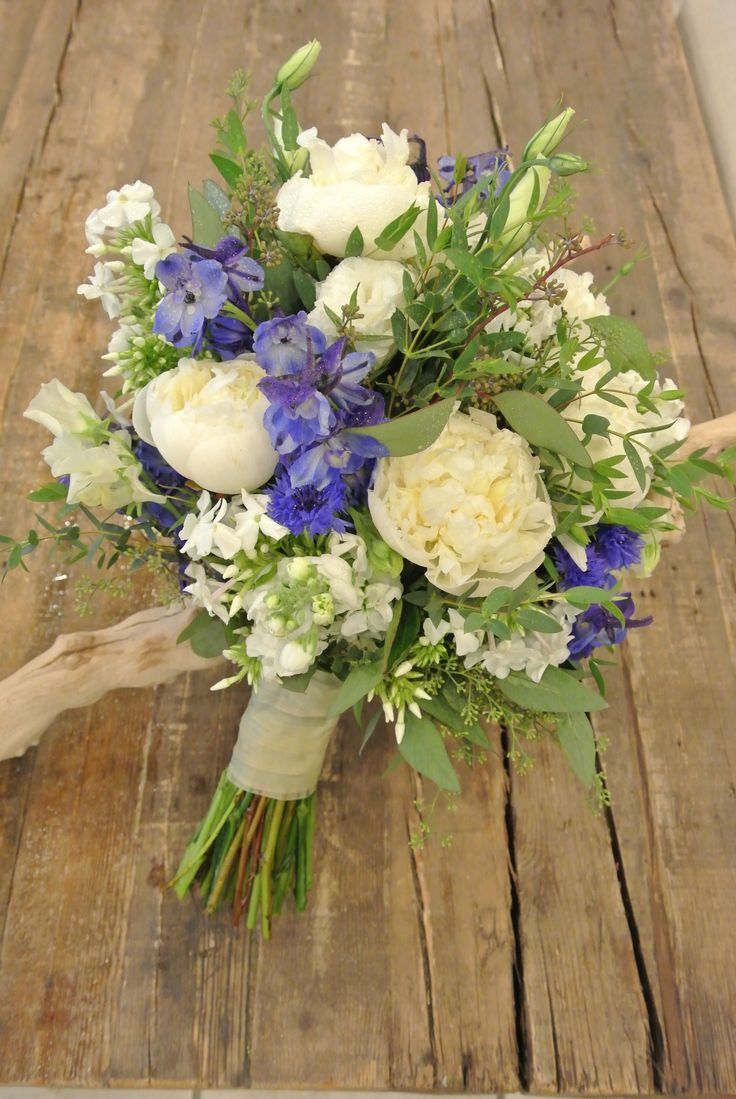 Bridal bouquet with blue delphiniums, peonies, stocks, phlox,sweetpeas, lisianthus and eucalyptus. Designed by Forget-Me-Not Flowers