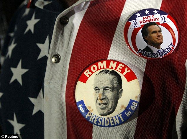 Decades: A supporter wears campaign buttons from Republican presidential candidate and former Massachusetts Governor Mitt Romney's 2012 campaign, and from the 1968 campaign of George Romney, Mitt Romney's father, in Tampa, Florida January 24, 2012
