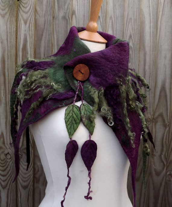 I have created this cowl using the wet felting technique. I have used non- mulsed merino, curly locks and silk. The colours are variegated sage green and