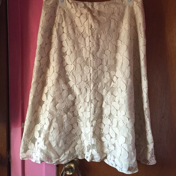 NWOT  Beige/Cream Lace Skirt NWOT-Beige Lace Skirt with Flowers inside slip back zipper New York & Co Stretch. Length 27 inches waist is 32 inches all around . Bought this when used size 8-10  but never wore       Well made skirt New York & Company Skirts Midi