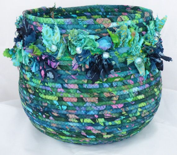 Large basket in blues found in Fijis pacific waters, kissed with touches of pink. Shirred triangles in coordinating batik fabrics meander